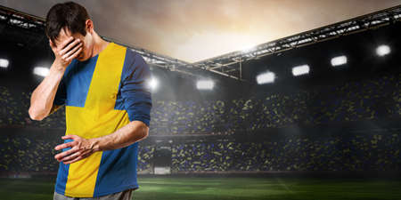 Sweden national team. Sad soccer or football player on stadium Standard-Bild - 103391802