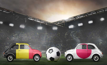 Belgium and Japan flags on cars with soccer or football ball at stadium