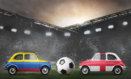 Colombia and England flags on cars with soccer or football ball at stadium