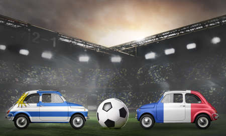 Uruguay and France flags on cars with soccer or football ball at stadium 写真素材