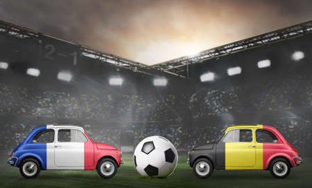 France and Belgium flags on cars with soccer or football ball at stadium Stock Photo