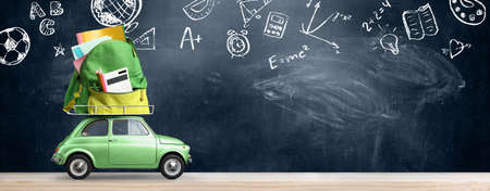 Back to school sale background. Car delivering backpack full of accessories against blackboard with education symbols.