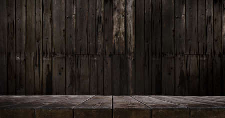 Wooden table and slightly blurred wooden wall 版權商用圖片