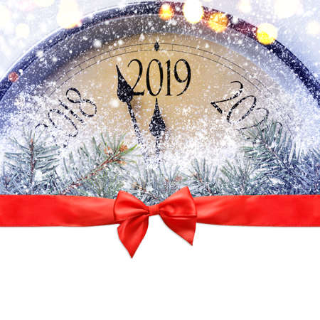 Countdown to midnight. Retro style clock is counting last moments before Christmas or New Year 2019 on blank white background, clipping path provided. View from above. Фото со стока - 107143644