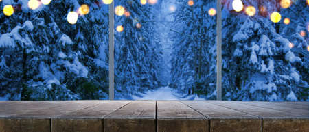 Empty table at home with panoramic view through window of snowy trees in winter forest background Stock fotó - 107217208