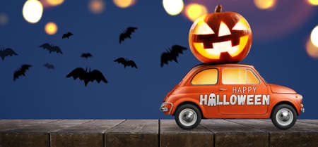 Halloween-Auto, das Kürbis gegen blauen Hintergrund liefert Standard-Bild - 109271253