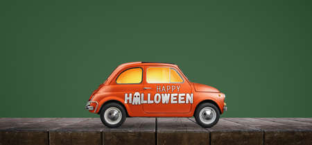Happy Halloween car against green background Stock Photo
