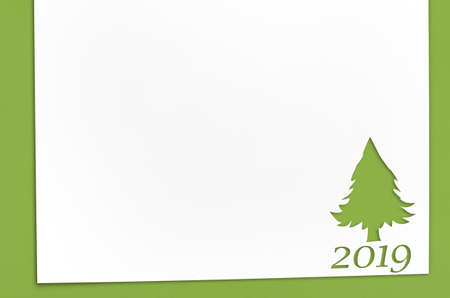 Cut paper in fir-tree shape for christmas card or new year background on green table Archivio Fotografico - 115048210
