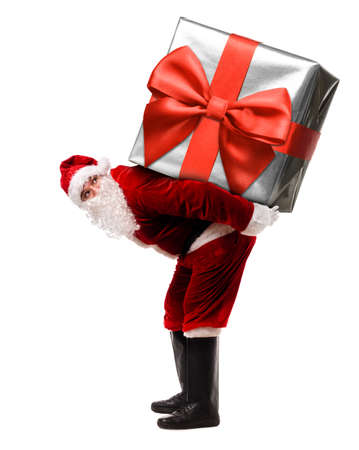 Santa Claus with giant Christmas present or New Year gift box isolated on white background