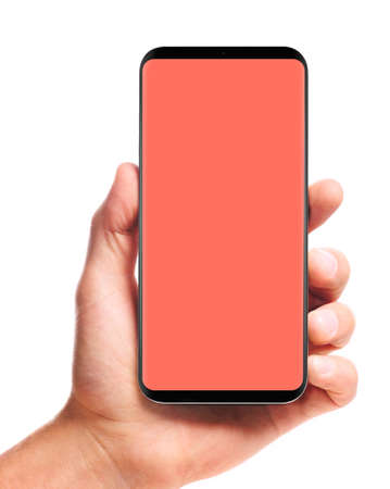male hand holding bezel-less smartphone with blank living coral screen, isolated on white background . Screen is cut out with path 版權商用圖片