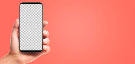 male hand holding bezel-less smartphone with transparent screen, isolated on living coral background . Screen is cut out with path