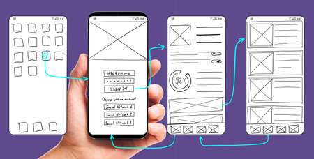 UI development. Male hand holding smartphone with wireframed user interface screen prototypes of a mobile application on ultra violet background. Stockfoto