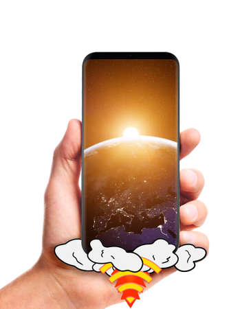 male hand hold launching smartphone with Sun rising over planet Earth on screen, isolated on white background.