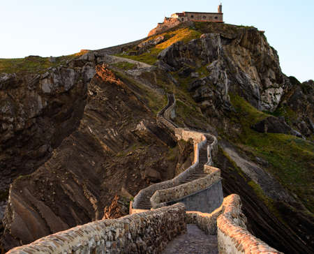 San Juan de Gaztelugatxe , its medieval stairs and bridge at sunset, Basque Country, Spain