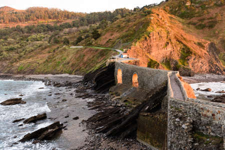 San Juan de Gaztelugatxe , its medieval stairs and bridge at sunset, Basque Country, Spain Stock Photo - 121171322
