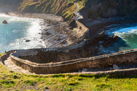 San Juan de Gaztelugatxe, its medieval stairs and bridge at sunrise, Basque Country, Spain Stock Photo - 121171321