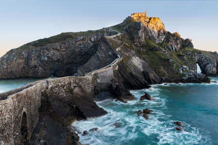 San Juan de Gaztelugatxe, its medieval stairs and bridge at sunrise, Basque Country, Spain Stock Photo - 121171328