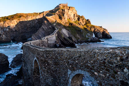 San Juan de Gaztelugatxe, its medieval stairs and bridge at sunrise, Basque Country, Spain