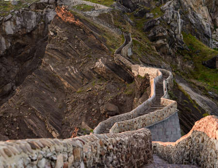 San Juan de Gaztelugatxe , its medieval stairs and bridge at sunset, Basque Country, Spain Stock Photo - 122780872
