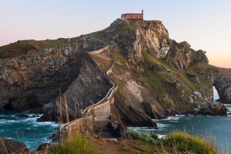 San Juan de Gaztelugatxe, its medieval stairs and bridge at sunrise, Basque Country, Spain Stock Photo - 122780873