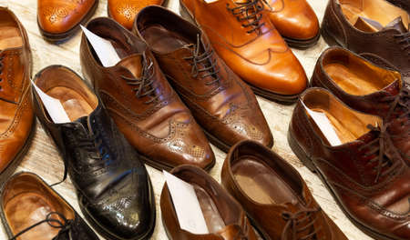 Leather shoes of different colors and types at shoe care service.
