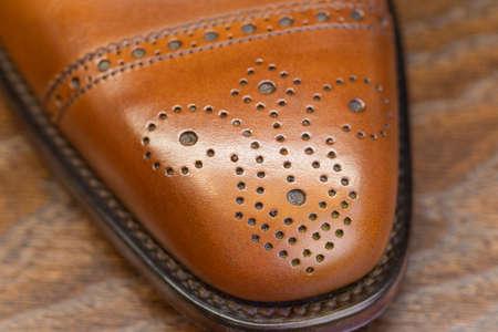 brown brogue toe of men full grain leather shoe, close up