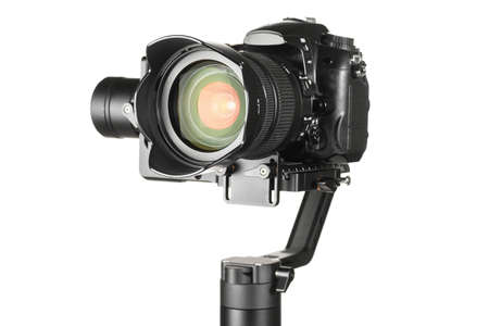 Gimbal three-axis motorized stabilizer with mounted DSLR camera isolated on white background