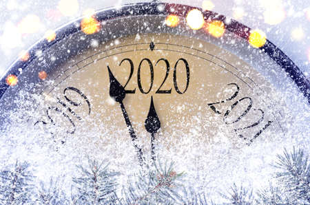 Countdown to midnight. Retro style clock counting last moments before Christmass or New Year 2020. Фото со стока