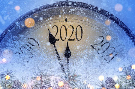 Countdown to midnight. Retro style clock counting last moments before Christmass or New Year 2020. Banco de Imagens