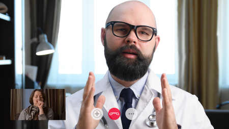 Telemedicine. Consultation with physician through mobile video call. Woman calling from home and talking to a doctor online. Screen interface, picture-in-picture (PiP)