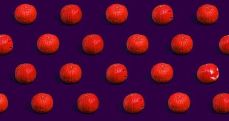 Halloween pumpkins Jack oLantern on purple background.