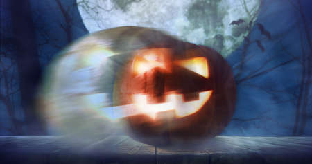 Halloween pumpkin lantern with ghost in night scary autumn forest. Spooky celebration background. Added grain and texture.