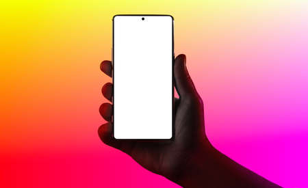 Hand holding phone. Silhouette of male hand holding smartphone isolated on multicolored background. Imagens
