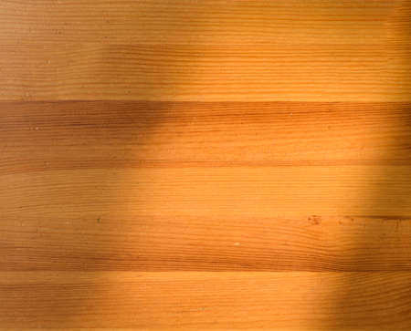 Top view of wooden table with shadow overlay Imagens