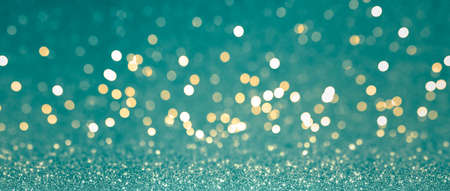 Abstract blurred background, yellow lights on blue background. Golden christmas or new year bokeh.