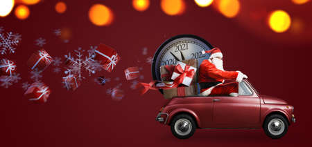 Christmas is coming. Santa Claus on toy car delivering New Year 2021 gifts and countdown clock at red background
