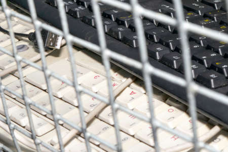 bans and restrictions on the Internet. keyboards from the computer lie in cell behind bars. focus on clack Banque d'images - 122730764