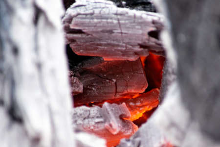 Burning firewood in the grill close up, coal background