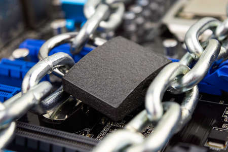 censorship, restrictions and restrictions on the Internet. concept, motherboard in chains under lock and key
