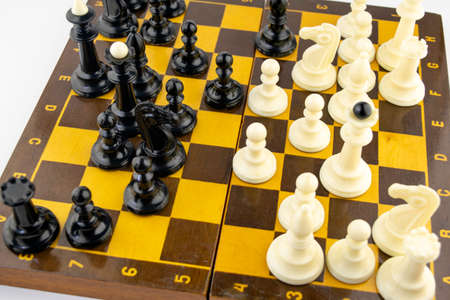 white chess pieces stand on a chessboard during the game of chess, top view