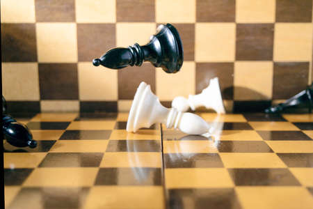 concept, chess pieces falling on the chessboard