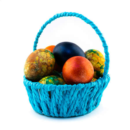 Easter eggs in the blue basket isolated on white background