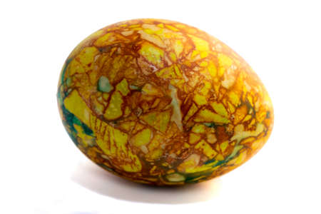 one yellow-green marbled egg isolated on the white background