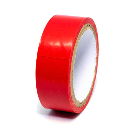 Roll of red plastic duct tape isolated on white background