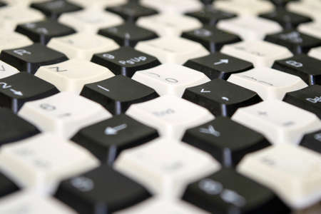 a set of keys from old computer keyboards laid out on the table in a staggered manner