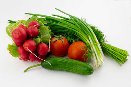 vegetables and greens on a white background close-up Stock Photo