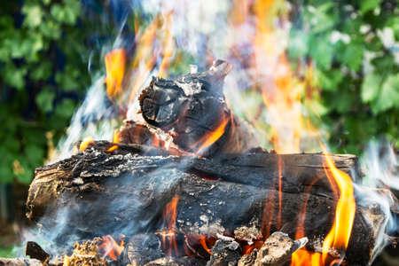 firewood burning on the brazier brazier, fire, coals, background Banco de Imagens