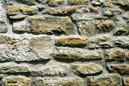 texture of masonry, the fragment of a stone wall of an ancient temple of the 10th century, background, backdrop Imagens