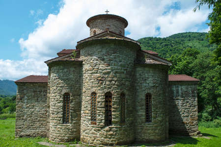10th century ancient Christian church, Nizhnearhizy temples, Northern Zelenchuk temple, ancient stone temple among mountains and vegetation