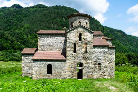 10th century ancient Christian church, Nizhnearhizy temples, Middle Zelenchuksky temple, ancient stone temple among mountains and vegetation